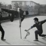 Dr. Tan practicing martial arts with his team members (1983)