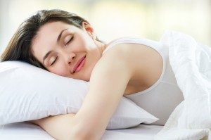woman-sleeping-pillow-300x199