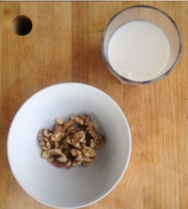 Handful of nuts and a small glass of milk before bed