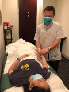 Dr. Tan treating a patient